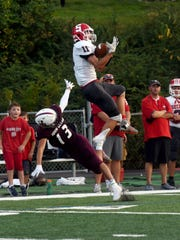Sheridan's Luken Hill makes a leaping grab over John Glenn's Jalen Driver in the first quarter. Hill caught a pair of touchdowns in the Generals' 13-12 comeback win on Friday night at McConagha Stadium.