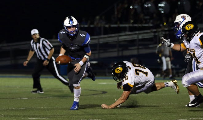 Zanesville's Ben Everson scrambles before throwing the game-sealing touchdown against Tri-Valley two weeks ago. The Blue Devils hit the road again this week, traveling to Wheeling Park, and focused on moving to 5-0.
