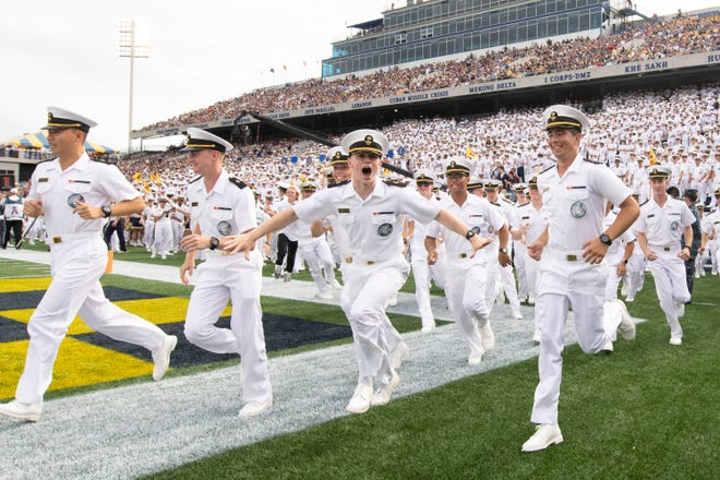 Navy Midshipmen reacts after a first quarter touchdown against the East Carolina Pirates at Navy-Marine Corps Memorial Stadium.