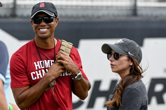 Tiger Woods, left, sports his Stanford Cardinal gear prior to the game against Central Florida.