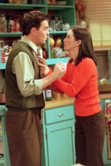 """Monica (Courteney Cox, left) and Chandler (Matthew Perry) try to hold on to their secret relationship in """"The One Where Everybody Finds Out."""""""