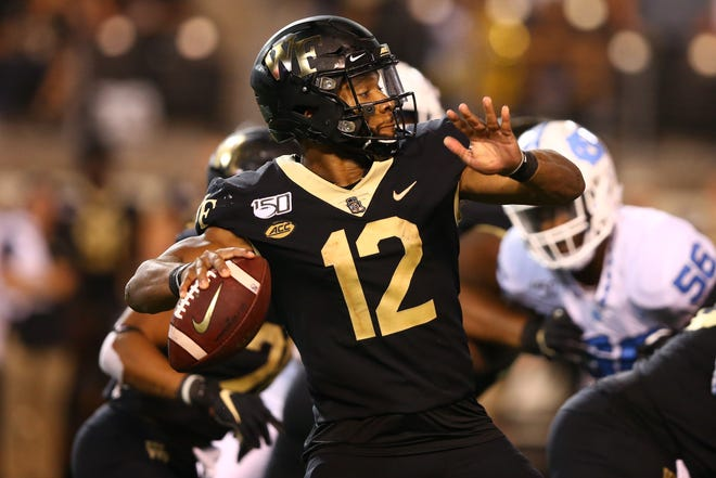 Wake Forest quarterback Jamie Newman went 14-for-26 for 214 yards and a touchdown, Friday night against North Carolina.