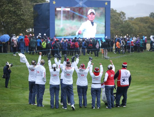 Solheim Cup: Team USA battles elements to take tie into decisive singles matches