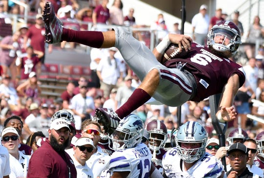 Mississippi State quarterback Garrett Shrader falls after being lofted into the air against Kansas State in the fourth quarter Saturday.