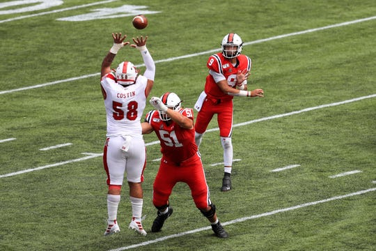 Sep 14, 2019; Cincinnati, OH, USA; Cincinnati Bearcats quarterback Desmond Ridder (9) throws a pass over Miami (Oh) Redhawks defensive lineman Doug Costin (58) in the first half at Nippert Stadium. Mandatory Credit: Aaron Doster-USA TODAY Sports