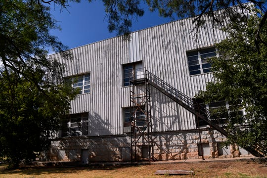 The rear of Stamford's Carnegie Library still shows the metal siding that used to cover the front of the building.