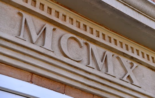 A roman numeral above the main entrance lists the date that Stamford's Carnegie Library was completed, 1910.