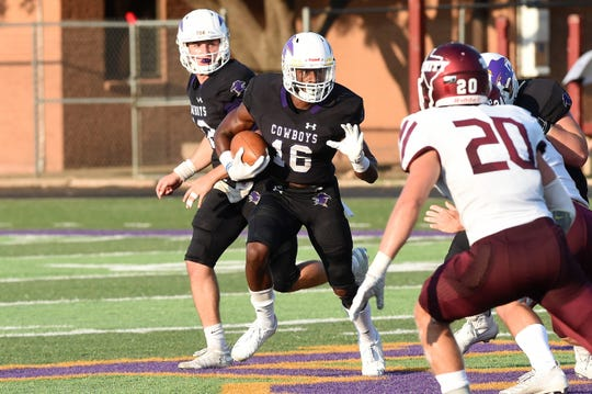 HSU running back Jaquan Hemphill (16) carries the ball after taking a handoff from Brennen Wooten (12) against Trinity. The Cowboys have several weapons on offense, but Hemphill is the leader and has the career rushing touchdown record to show for it.