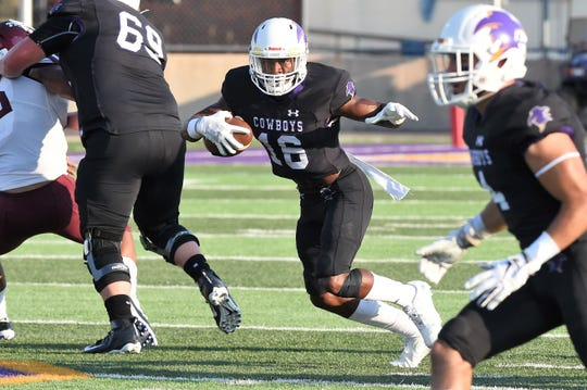 HSU's Jaquan Hemphill (16) carries the ball against Trinity at Shelton Stadium on Sept. 14. The Cowboys pulled out a 16-10 win.
