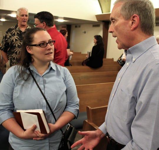 Karen Cooke, guest preacher Sunday at Minter Lane Church of Christ, talks with church shepherd Doug Foster after the service.