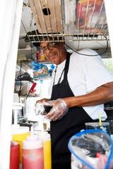 Anderson Davis brings his hot dog trailer to the Buncombe County Courthouse from early spring to late fall.