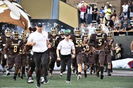 The Western Michigan football team take the field at Waldo Stadium in Kalamazoo before its game against Georgia State on Saturday, Sept. 14, 2019.