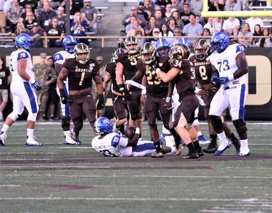 Western Michigan linebacker Treshaun Hayward (23) celebrates his sack of Georgia State quarterback Dan Ellington (13) during the first quarter at Waldo Stadium in Kalamazoo on Saturday, Sept. 14, 2019.
