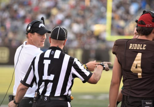 Western Michigan head coach Tim Lester talks with the line judge ahead of the Broncos game against Georgia State at Waldo Stadium in Kalamazoo on Saturday, Sept. 14, 2019.