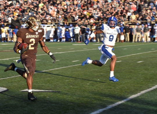 Western Michigan running back LeVante Bellamy (2) sprints past Georgia State defensive back Cedric Stone (9) on his way to a 60 yard touchdown run at Waldo Stadium in Kalamazooo on Saturday, Sept. 14, 2019.