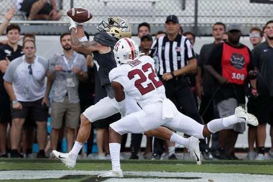 Central Florida wide receiver Tre Nixon, of Viera, makes a catch in front of Stanford cornerback Obi Eboh (22) for a 38-yard touchdown during the first half of Saturday's game in Orlando.