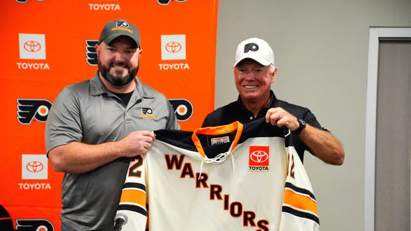 Marine Corps Sgt. Jim Young, will be the captain of the Flyers Warriors. He was presented with a jersey Saturday by Hall of Famer Bobby Clarke.