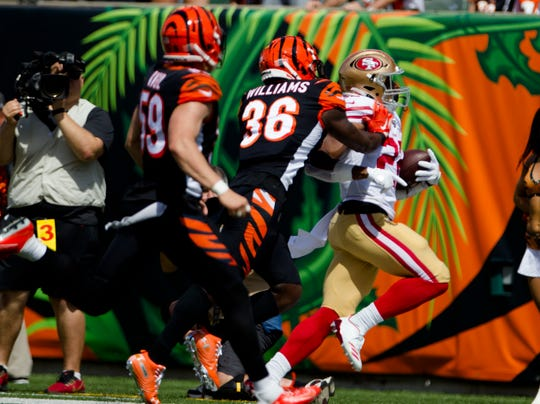Cincinnati Bengals strong safety Shawn Williams (36) forces San Francisco 49ers running back Matt Breida (22) out of bounds in the second quarter of the NFL game between Cincinnati Bengals and San Francisco 49ers at Paul Brown Stadium in Cincinnati on Sunday, Sept. 15, 2019.