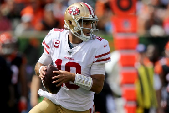 San Francisco 49ers quarterback Jimmy Garoppolo (10) rolls out of the pocket in the first quarter of a Week 2 NFL football game against the Cincinnati Bengals, Sunday, Sept. 15, 2019, at Paul Brown Stadium in Cincinnati.