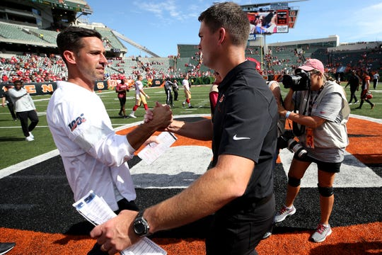 San Francisco 49ers head coach Kyle Shanahan, left, and Cincinnati Bengals head coach Zac Taylor, right, shakes hands at the end of a Week 2 NFL football game, Sunday, Sept. 15, 2019, at Paul Brown Stadium in Cincinnati.