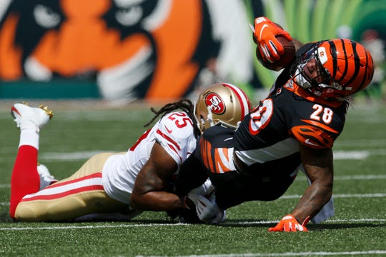 Cincinnati Bengals running back Joe Mixon (28) is brought down after a catch in the first quarter of the NFL Week 2 game between the Cincinnati Bengals and the San Francisco 49ers at Paul Brown Stadium in Cincinnati on Sunday, Sept. 15, 2019. The 49ers led 24-10 at halftime.