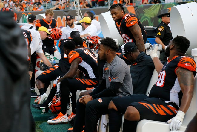Cincinnati Bengals running back Joe Mixon (28) sits on the bench in the fourth quarter of the NFL Week 2 game between the Cincinnati Bengals and the San Francisco 49ers at Paul Brown Stadium in Cincinnati on Sunday, Sept. 15, 2019. The Bengals fell to 0-2 on the season with a 41-17 loss to the 49ers in the home opener.