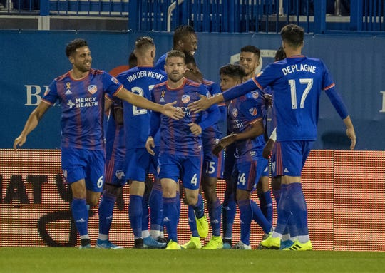 Sep 14, 2019; Montreal, Quebec, CAN; FC Cincinnati midfielder Allan Cruz (15) celebrates his goal against Montreal Impact with teammates during the first half at Stade Saputo.