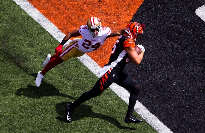 Cincinnati Bengals tight end Tyler Eifert (85) scores a touchdown as San Francisco 49ers defensive back K'Waun Williams (24) attempts to stop him in the first quarter of the NFL game between Cincinnati Bengals and San Francisco 49ers at Paul Brown Stadium in Cincinnati on Sunday, Sept. 15, 2019.