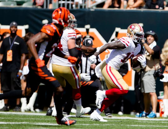 San Francisco 49ers wide receiver Deebo Samuel (19) runs downfield in the second quarter of the NFL game between Cincinnati Bengals and San Francisco 49ers at Paul Brown Stadium in Cincinnati on Sunday, Sept. 15, 2019.