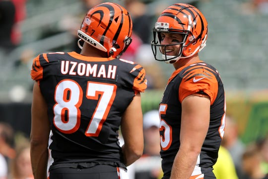 Cincinnati Bengals tight end Tyler Eifert (85) and Cincinnati Bengals tight end C.J. Uzomah (87) share a laugh during warm ups before kickoff of a Week 2 NFL football game against the San Francisco 49ers, Sunday, Sept. 15, 2019, at Paul Brown Stadium in Cincinnati.