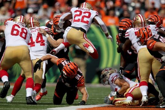 San Francisco 49ers running back Matt Breida (22) hurdles Cincinnati Bengals defensive end Sam Hubbard (94) on a carry in the first quarter of a Week 2 NFL football game against the Cincinnati Bengals, Sunday, Sept. 15, 2019, at Paul Brown Stadium in Cincinnati.