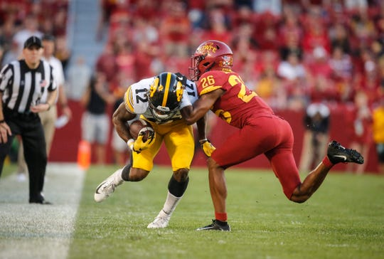 Iowa junior receiver Brandon Smith is pushed out of bounds by Iowa State defensive back Anthony Johnson in the second quarter on Saturday, Sept. 14, 2019, at Jack Trice Stadium in Ames.