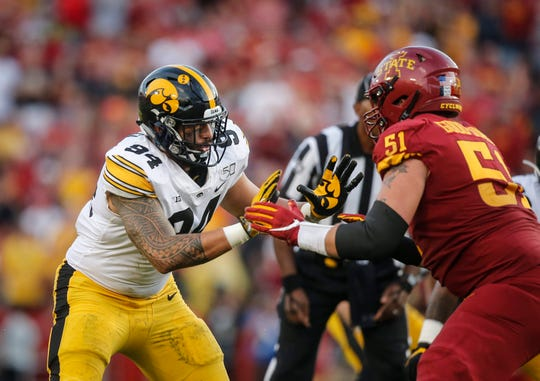 Iowa junior defensive end A.J. Epenesa battles Iowa State's Julian Good-Jones on the line in the second quarter on Saturday, Sept. 14, 2019, at Jack Trice Stadium in Ames.