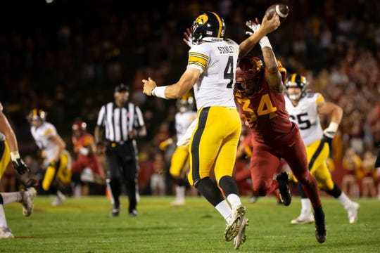 Iowa State linebacker O'Rien Vance (R-So.) (34) knocks the ball out of the hands of Iowa senior quarterback Nate Stanley (4) during the Cy-Hawk football game at Jack Trice Stadium on Saturday, Sept. 14, 2019 in Ames. Iowa would go on to defeat Iowa State 18-17.