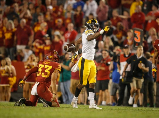 Iowa wide receiver Ihmir Smith-Marsette points ahead after pulling in a catch for a first down in the third quarter against Iowa State on Saturday, Sept. 14, 2019, at Jack Trice Stadium in Ames.
