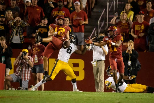 Iowa State defensive back Greg Eisworth (R-Jr.) (12) nearly intercepts a pass intended for Iowa junior wide receiver Ihmir Smith-Marsette (6) during the Cy-Hawk football game at Jack Trice Stadium on Saturday, Sept. 14, 2019 in Ames. Iowa would go on to defeat Iowa State 18-17.