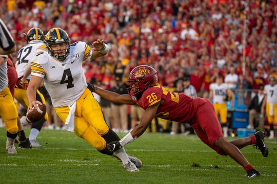 Iowa State defensive back Anthony Johnson (So.) (26) sacks Iowa senior quarterback Nate Stanley (4) during the Cy-Hawk football game at Jack Trice Stadium on Saturday, Sept. 14, 2019 in Ames. Iowa State took a 7-6 lead over Iowa into halftime.