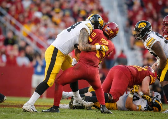 Iowa State sophomore quarterback Brock Purdy barely gets the ball away before getting pummeled by Iowa defensive end A.J. Epenesa in the third quarter on Saturday, Sept. 14, 2019, at Jack Trice Stadium in Ames.