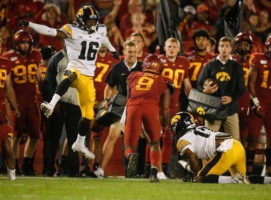 Iowa's Terry Roberts (16) celebrates after the Hawkeyes recovered a muffed punt by Iowa State to clinch their win and the Cy-Hawk Trophy.