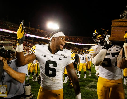 Ihmir Smith-Marsette celebrates after Iowa's 18-17 win against Iowa State.