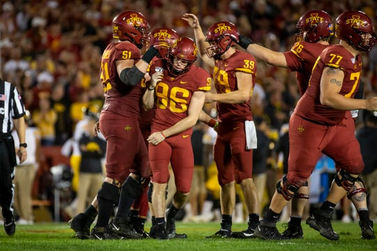 Iowa State place kicker Connor Assalley (R-Jr.) (96) is congratulated after kicking a field goal to make the score 17-15 during the Cy-Hawk football game at Jack Trice Stadium on Saturday, Sept. 14, 2019 in Ames. Iowa would go on to defeat Iowa State 18-17.