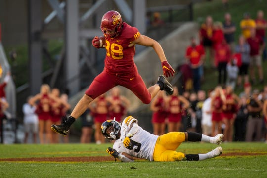 Iowa State tight end Charlie Kolar (R-So.) (88) jumps over Iowa junior defensive back Geno Stone (9) during the Cy-Hawk football game at Jack Trice Stadium on Saturday, Sept. 14, 2019 in Ames. Iowa State took a 7-6 lead over Iowa into halftime.
