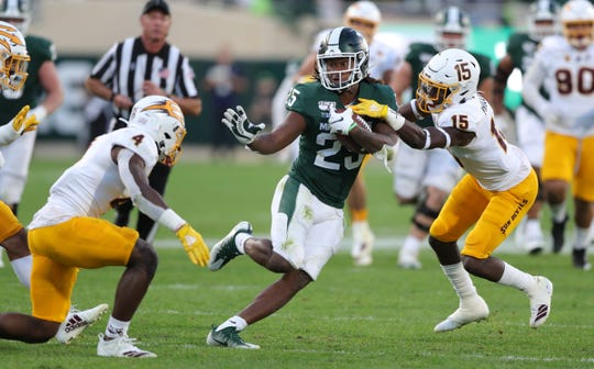 Michigan State Spartans receiver Darrell Stewart Jr. is tackled by Arizona State defensive back Evan Fields (4) and linebacker Stanley Lambert during the second half Saturday, Sept. 14, 2019 at Spartan Stadium.