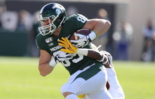 Michigan State Spartans tight end Matt Dotson makes a catch against Arizona State during the first half Sept. 14, 2019 at Spartan Stadium.