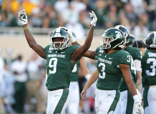 Michigan State Spartans safety Dominique Long (9) celebrates after a tackle vs. Arizona State player during the second half Sept. 14, 2019 at Spartan Stadium.