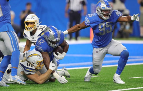 Detroit Lions linebacker Devon Kennard (42) and defensive end Romeo Okwara (95) celebrate after recovering a fumble by Los Angeles Chargers running back Austin Ekeler (30) at the goal line during the second half Sunday, Sept. 15, 2019 at Ford Field.