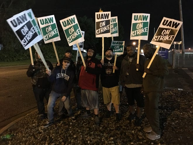 Striking janitors, who work for Aramark and are UAW members, picket outside General Motors' Flint Assembly Plant last month. The janitors have reached a tentative agreement with Aramark, according to a source.