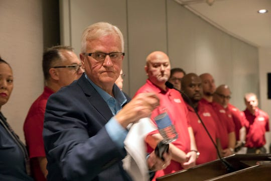 Terry Dittes, vice president of the UAW-GM department, leaves the podium after announcing a national GM worker strike.