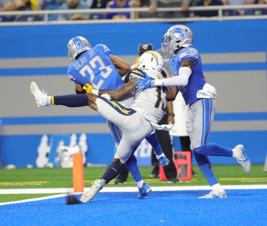 Detroit Lions cornerback Darius Slay (23) makes the game-saving interception against the Los Angeles Chargers during the fourth quarter of Sunday's game at Ford Field.