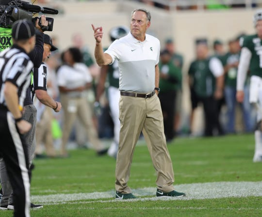 Mark Dantonio walks off the field after the 10-7 loss to Arizona State on Saturday.